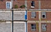 Abandoned warehouse with bricks and broken windows