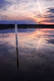 Adirodack flood with pink sunset and depth gauge reflection