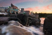 Abandoned Mill at Sunset with Waterfall