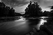 Black and white long exposure of an island in adirondack river at sunset