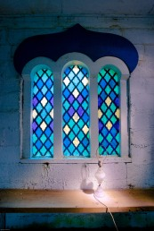 abandoned church with lamp and stained glass