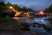 Adirondack river at blue hour with hydroelectric facility and dam