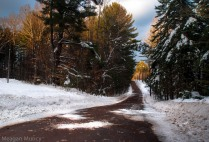 Adirondack dirt road during the winter around susnet