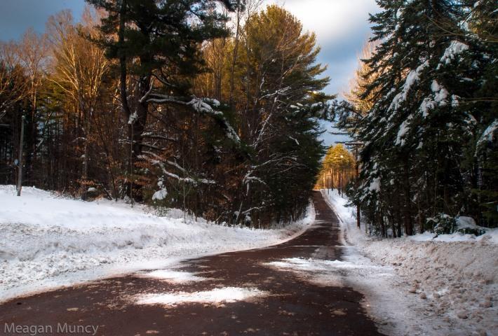 Adirondack dirt road during the winter around susnet