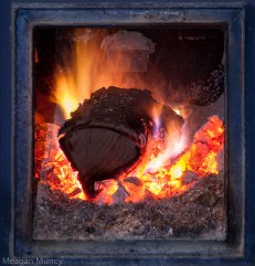 Log on fire in wood stove (Timberline stove)