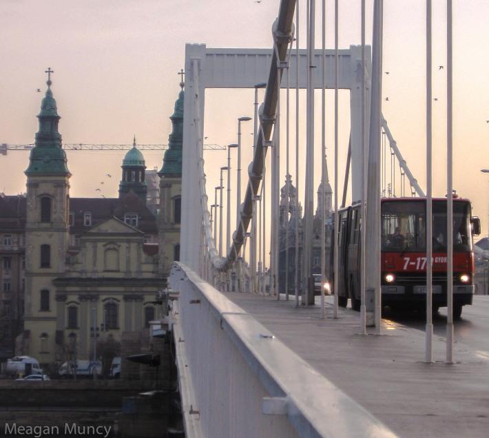 Church, bridge, and bus.