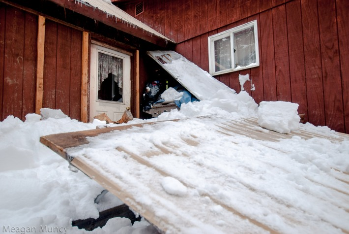 Roof and porch destroyed by heavy snow and weather
